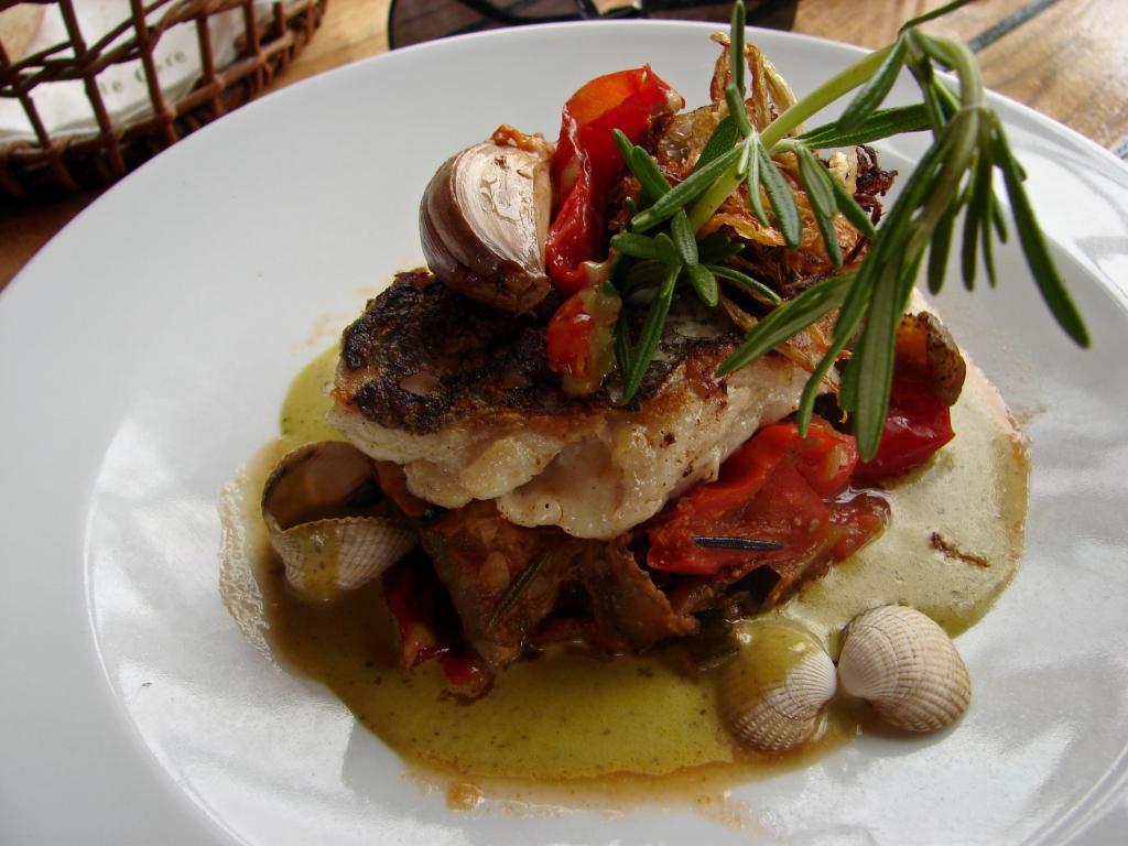 roasted hake steak, Ratatouille, virgin olive oil and watercress cream with cockles