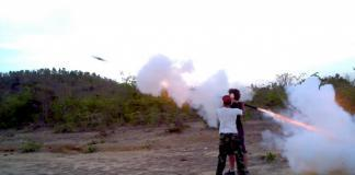 Shooting a bazooka in Cambodia