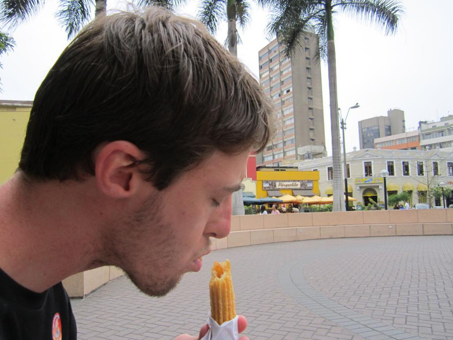 Peruvian Food - Eating a Churro in Peru